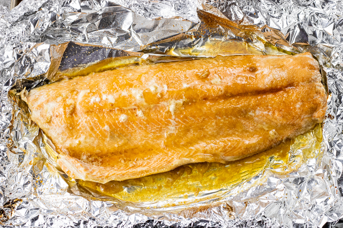 salmon on foil with melted butter and brown sugar