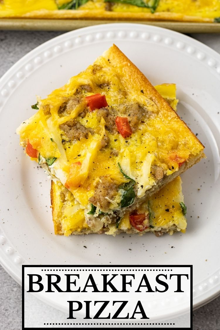 Breakfast Pizza is a simple one pan breakfast idea that has a crescent roll crust topped with eggs, sausage, cheese, hash browns, peppers and spinach. This breakfast pizza recipe is perfect for a simple breakfast for the fam or make a batch for brunch with friends.