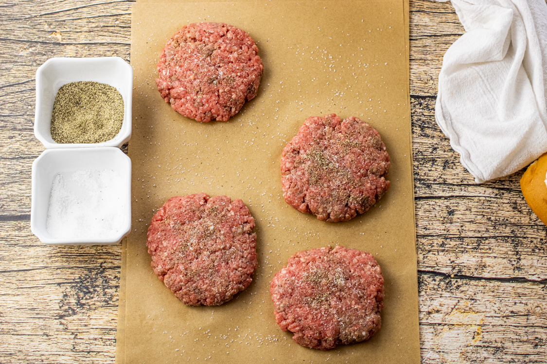 beef patties on a piece of parchment paper