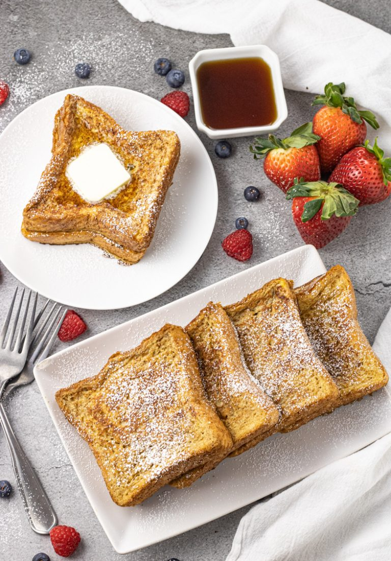 pile of french toast on white plates