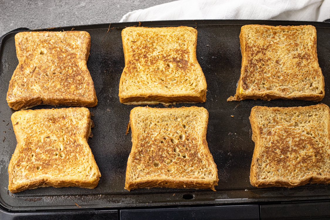 cooking french toast on a black skillet