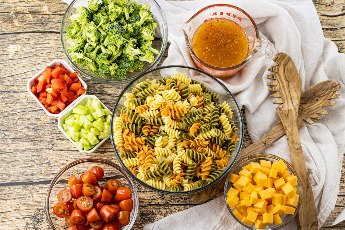 bowls of ingredients for pasta salad