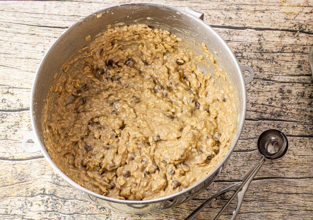 banana oatmeal cookie dough in a metal mixing bowl