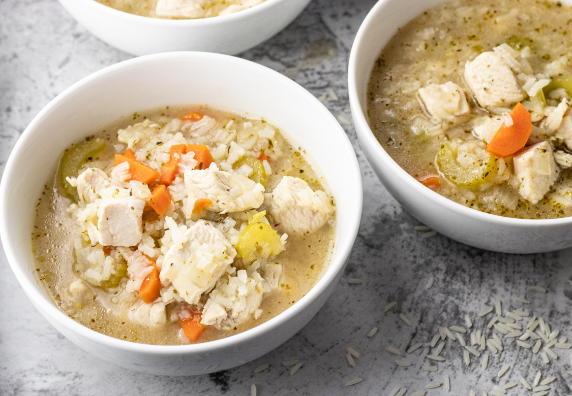bowl of soup with rice and chicken