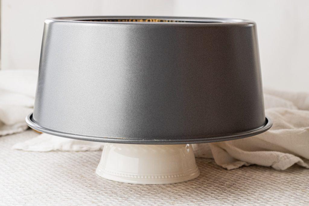 tube cake pan upside down on a small ramekin