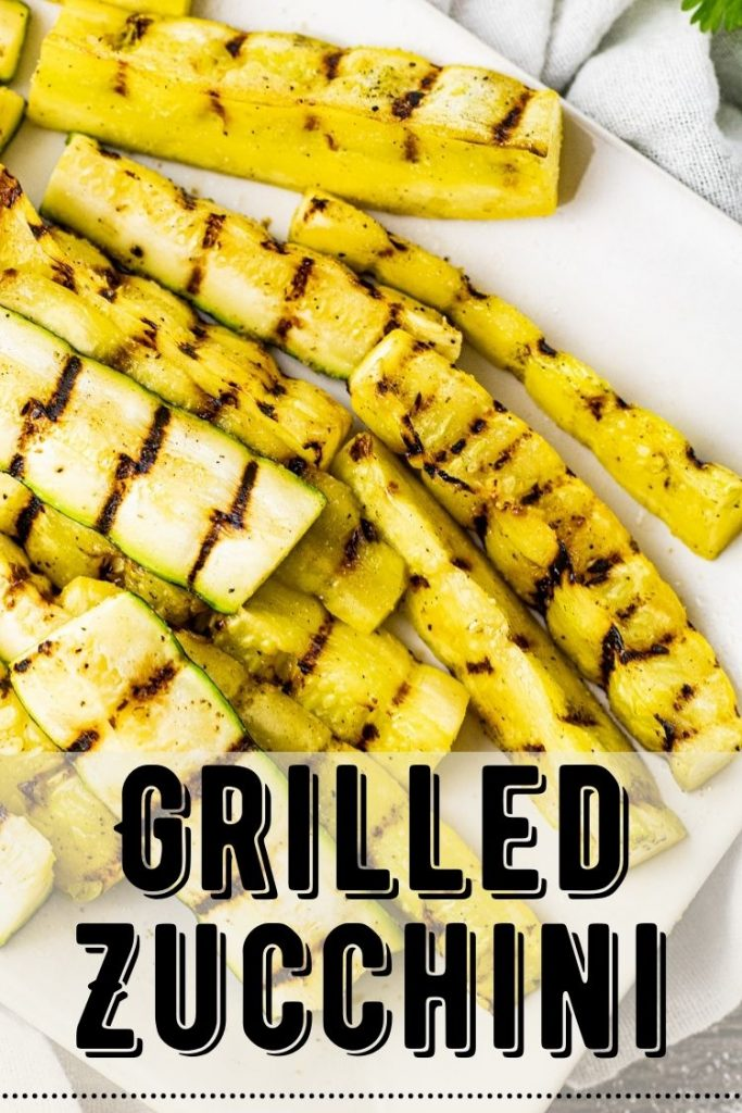 grilled zucchini and yellow squash on a white plate