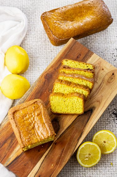 slices of yellow lemon bread on a wooden platter