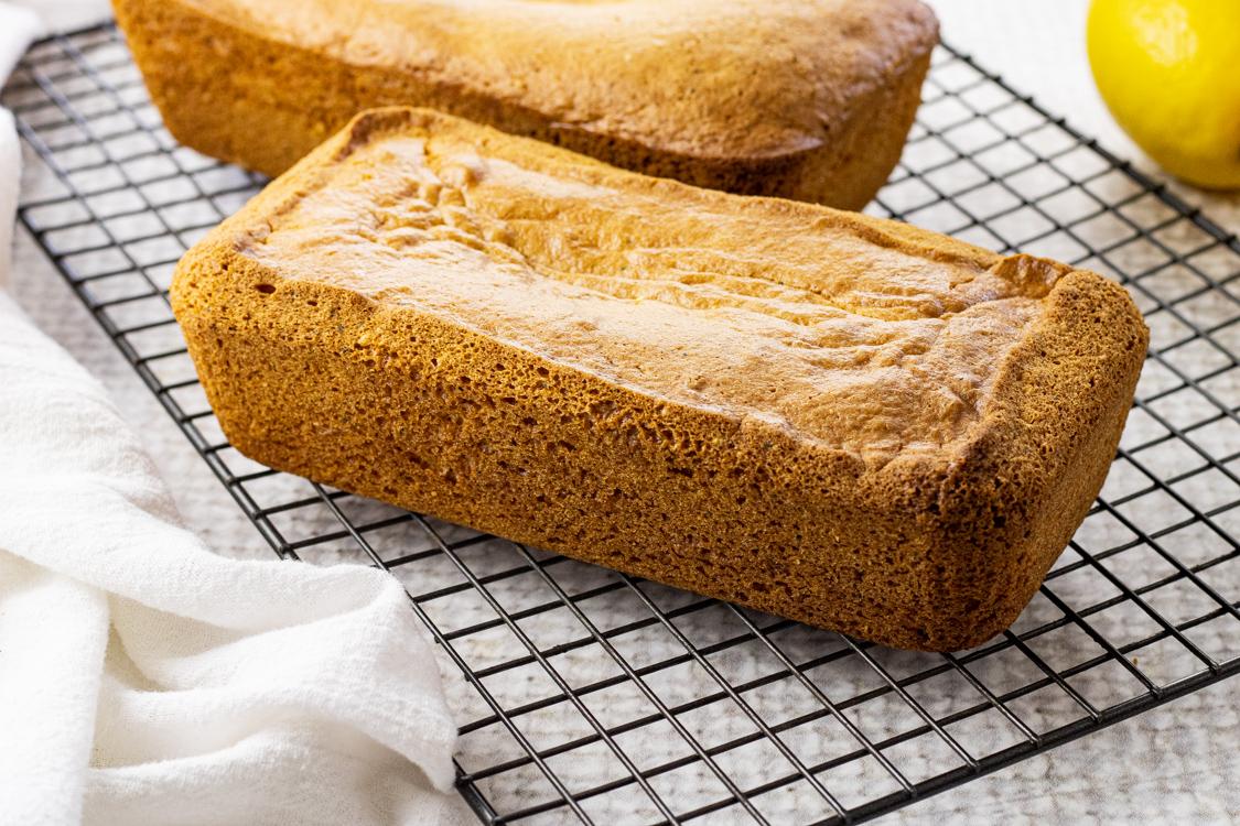 glazed loaves of lemon poppyseed bread on a cooling rack
