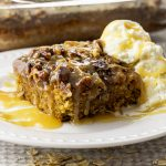 slice of oatmeal cake topped with pecans and coconut