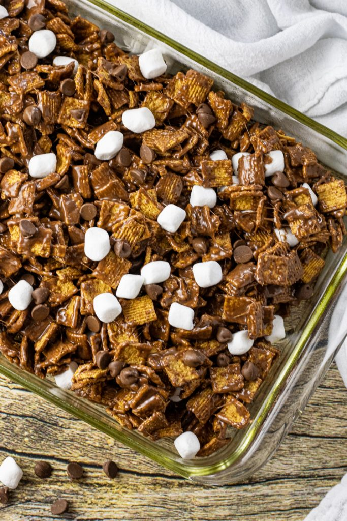 glass pan of golden graham cereal smores bars with chocolate and marshmallows