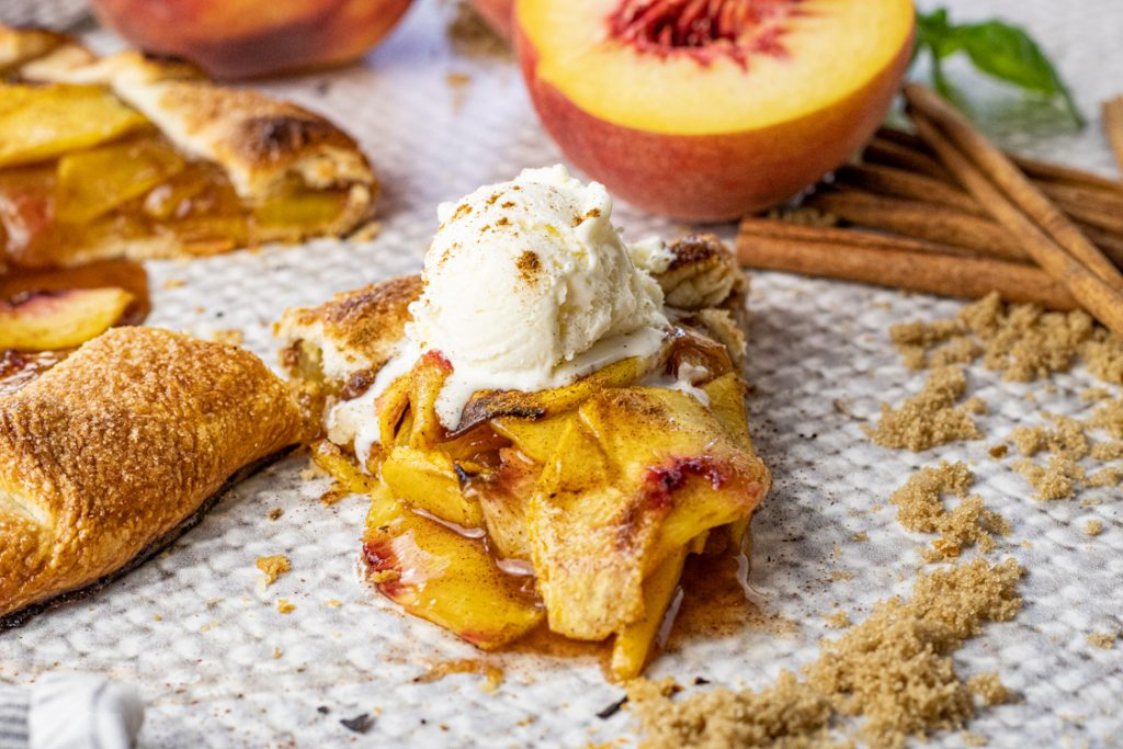 slice of sliced peaches topped with ice cream