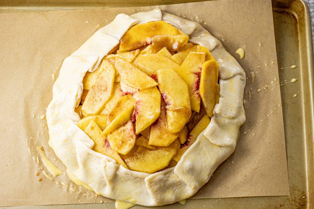 pie crust wrapped around sliced peaches