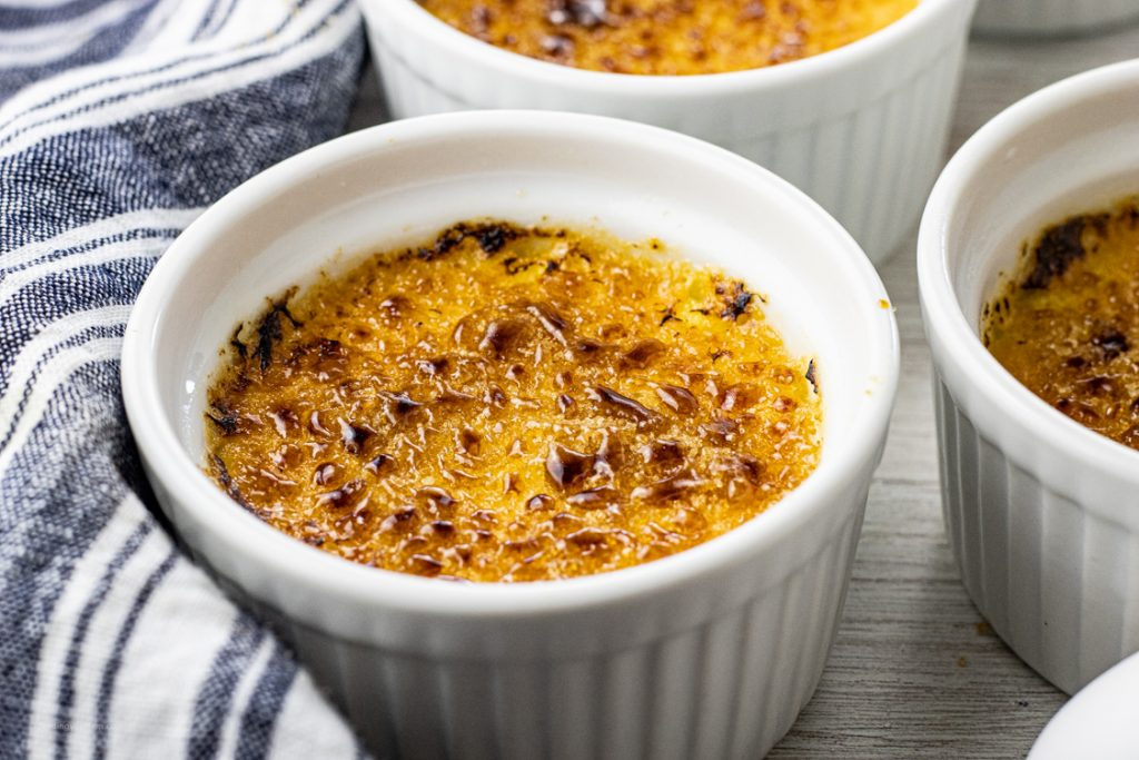 small ramekin of custard topped with torched sugar