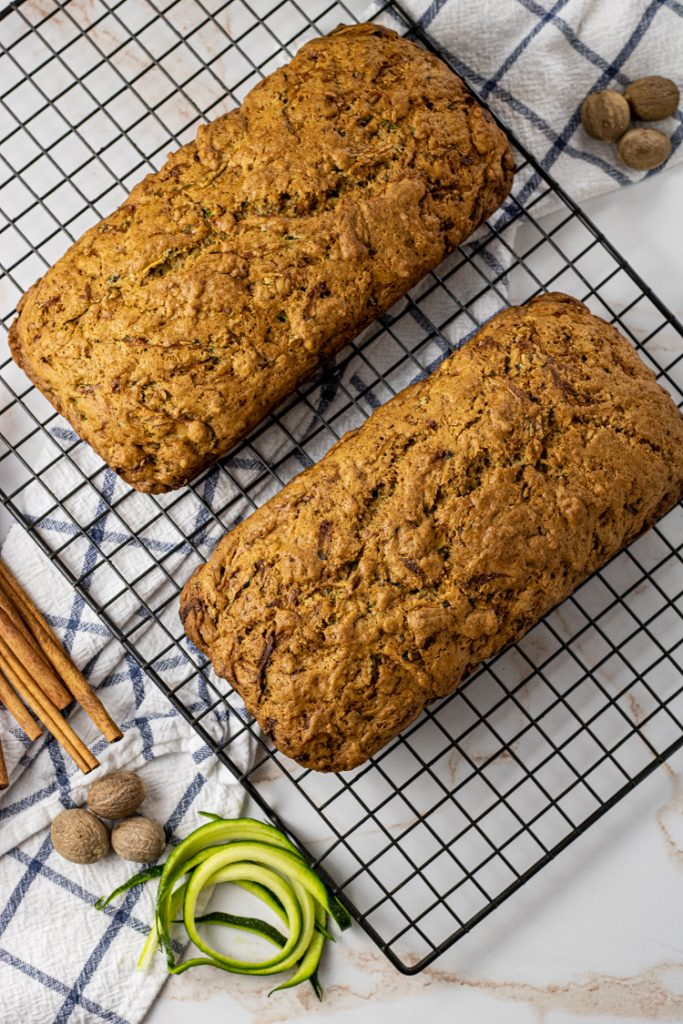 two loaves of zucchini bread on a cooling rack