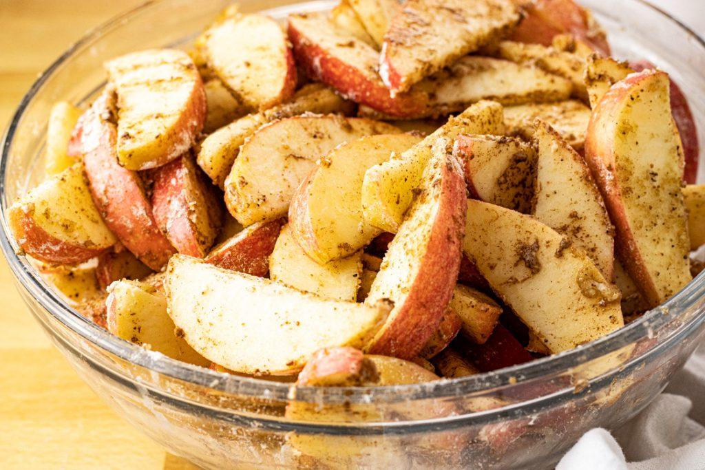 apples coated in cinnamon, nutmeg and brown sugar