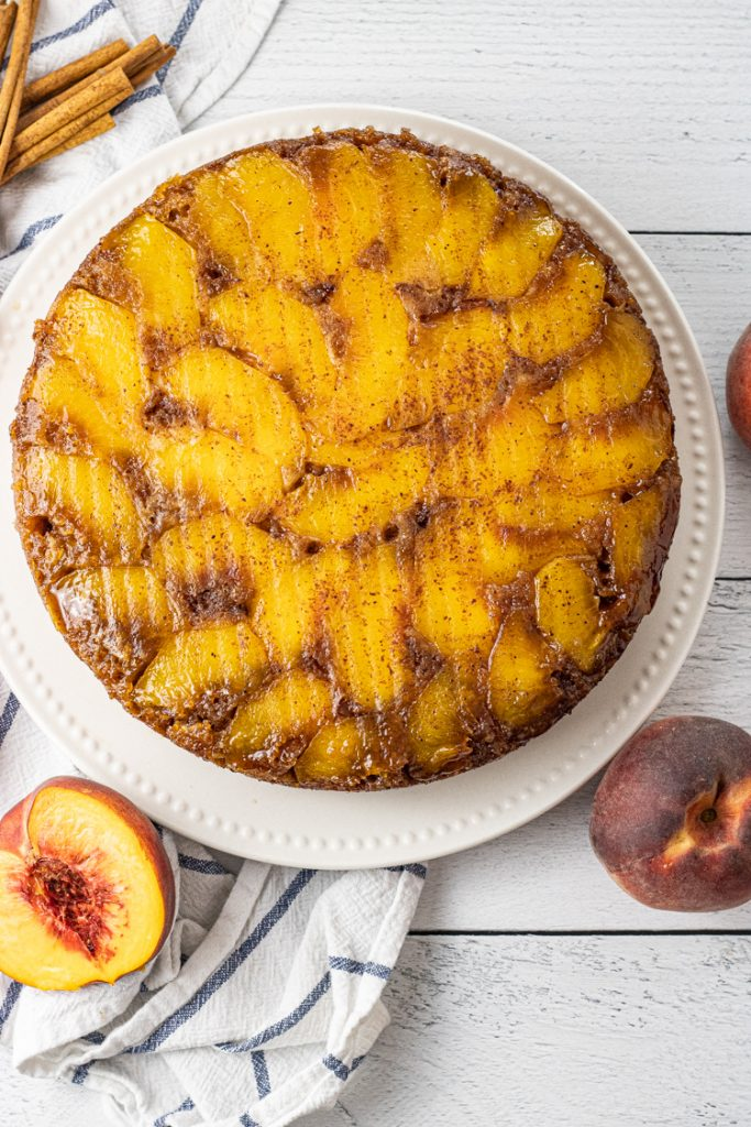round peach upside down cake on a white plate
