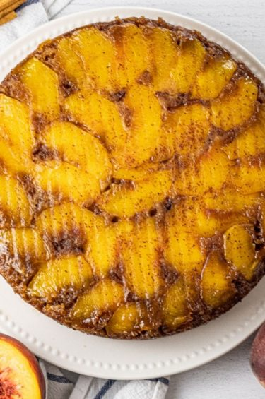 cake with peaches on top
