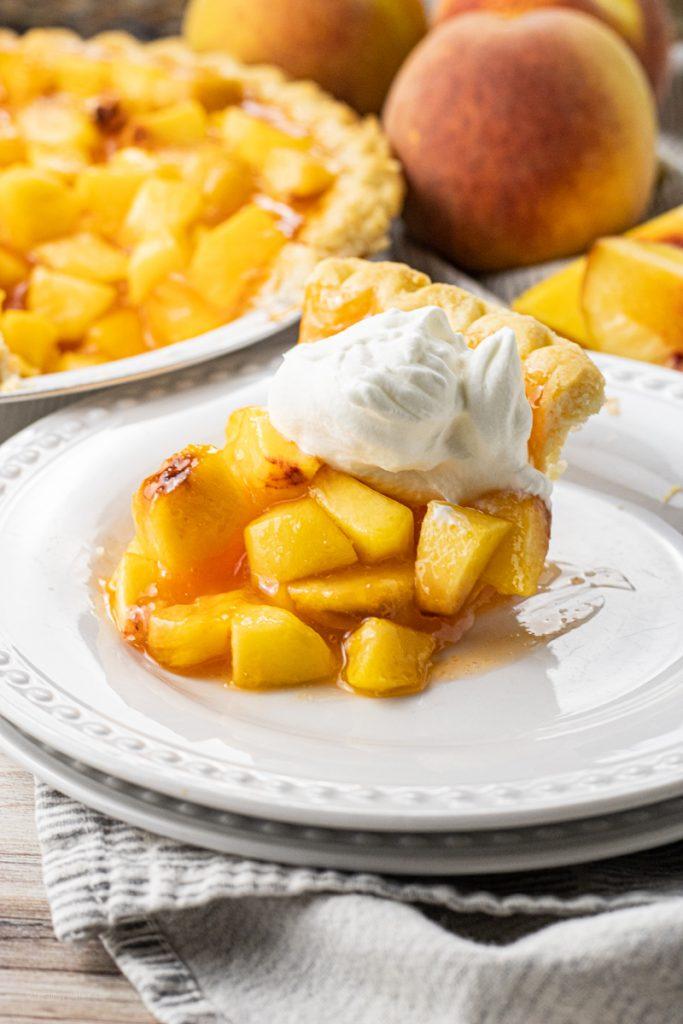 chopped peaches in a pie on a white plate